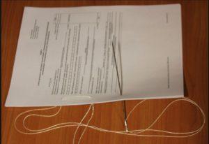 При сшивании документов сколько нужно делать дырок